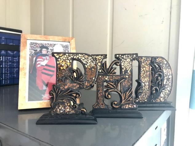 Wooden letters P, H, D