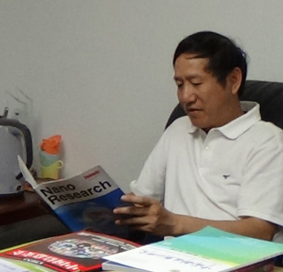 Dr. Yan at his desk